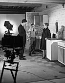 Designer in a photographic studio, 1964
