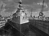 Battleship HMS Malaya in a floating dock, Malta, c1937