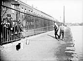Boys fishing across a canal towpath, London, c1905