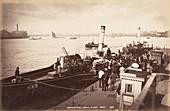 Paddle steamer disembarking passengers, c1890