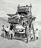Arabian children enjoying a 'big-wheel', 1922