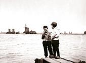 Boys by a canal, Laandam, Netherlands, 1898
