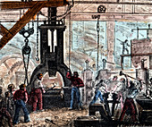 Steam hammer being used in an ironworks, France, 1867