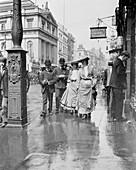 Two suffragettes walking along a pavement, London, 1900s