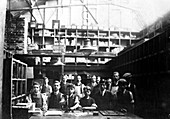 Men and boys in a printing workshop