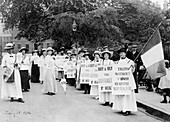 Suffragettes on a 'poster parade' selling the Suffragette