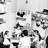 A family dining in their London home, c1950s