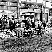 Road repairs in Portobello Road, London, c1956