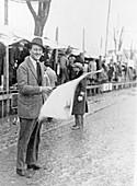 Carlo Masetti waving a flag