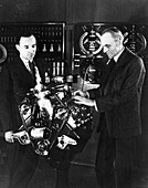 Henry and Edsel Ford with a Ford V8 engine