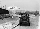 Car near a road sign, Bromley, Kent, 1920s
