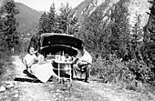 Couple with Vauxhall Wyvern enjoying a picnic, c1950