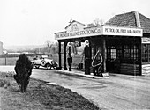 1923 10 hp Calcott arriving at a petrol station