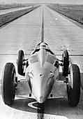 Bernd Rosemeyer in Auto Union record-breaking car, 1937