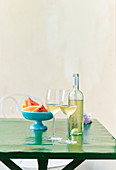 Still life with cold white wine and fruits