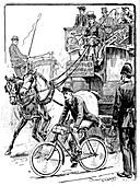 Cyclist in busy London traffic