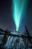 Aurora Borealis over a mountain in Alaska