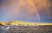 Rainbow over icecliffs, Svalbard