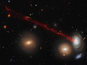 D100 spiral galaxy with a tail of gas