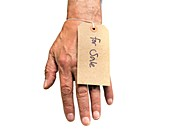Hand with For Sale label