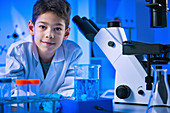 Schoolboy doing science experiment