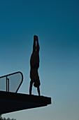 Handstand diver on diving platform
