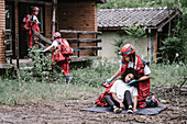 Rescue team helping injured woman
