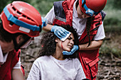 Rescue team treating injuries in the field