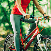 Woman cycling in a park