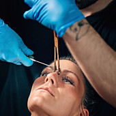 Nose bridge piercing