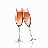 Two pink champagne in flutes toasting, illustration