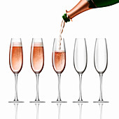Bottle of pink champagne pouring into flutes, illustration