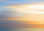 Defocused view of sunset over ocean, illustration