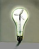Wind turbine inside illuminated light bulb, illustration