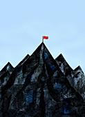 Red flag on mountain summit, illustration