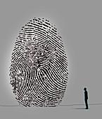 Man looking up at large fingerprint, illustration