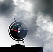 Empty fuel gauge on globe, illustration