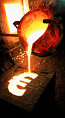 Molten metal pouring into euro sign mold, illustration