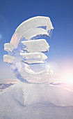 Frozen euro sign on top of mountain, illustration