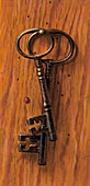 Old-fashioned keys hanging on nail, illustration
