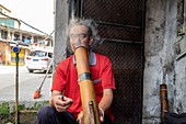 Man smoking water pipe, China