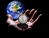 Earth with hand and stopwatch