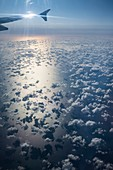 Cumulus humilis clouds seen from an aircraft over the sea