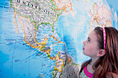 Girl looking at map of the USA