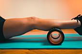 Massaging calf muscles with foam roller