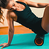 Using foam roller for muscle and fascia massage