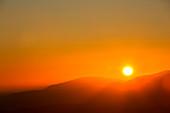 Sun setting behind Coniston Old Man,Lake District,UK