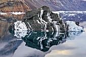 Iceberg with layered englacial sediment