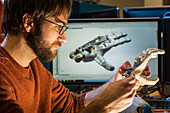 Engineer working on Romeo robot hand