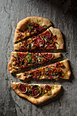 Pizza with blue cheese, figs and carmelised onion
